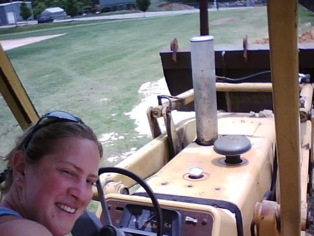 Sarah driving backhoe at CC