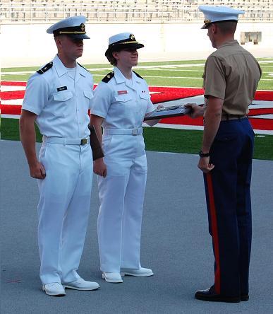 Lydia receiving Ironwoman award from Capt. Rosenthal